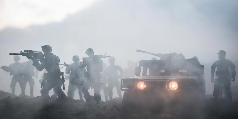 Soldiers and vehicle in a fog