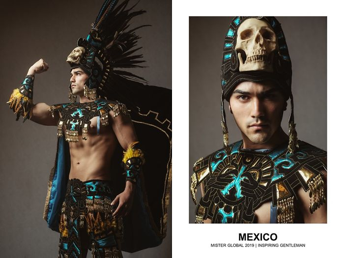 Man in a Mexican national costumes: Aztec embroidery, turquoise, gold, and black, feathered headdress.