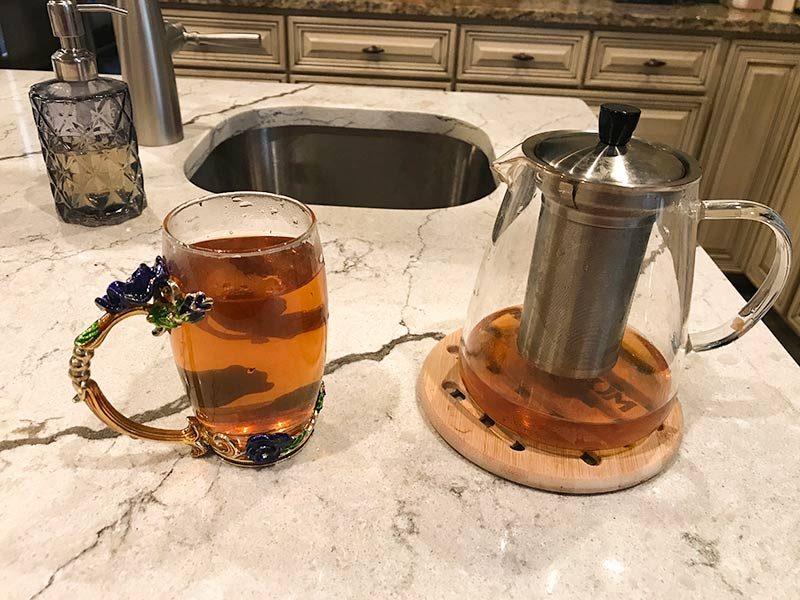 Picture of a tea pot and some tea in a pretty mug